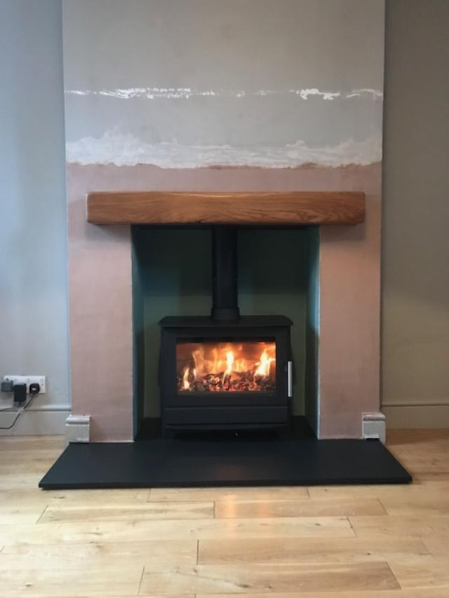 Hunter stove with oak beam over, installed in Cranbrook.