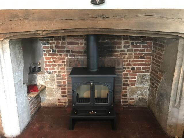 Double door stove in Inglenook fireplace