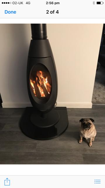 Spatherm wood burning stove on slate hearth