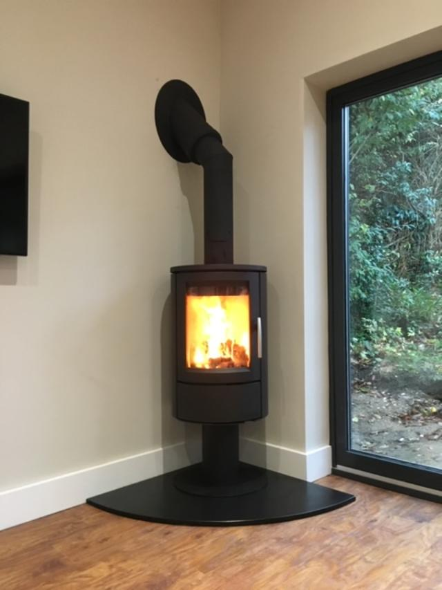 Scan wood burning stove on pedestal