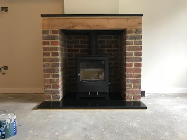 Morso stove in brick built fireplace