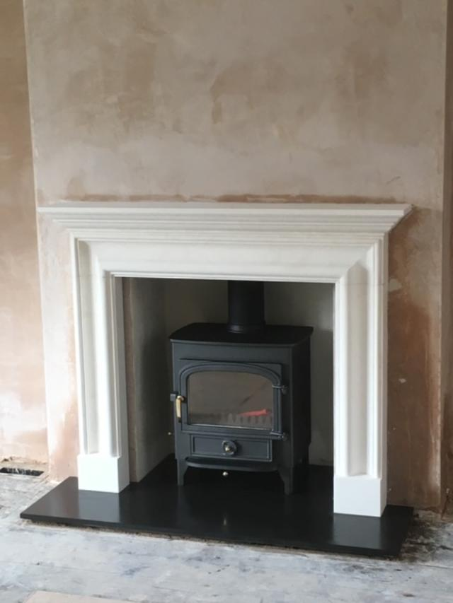 Clearview Vision 500 log burner in marble fireplace