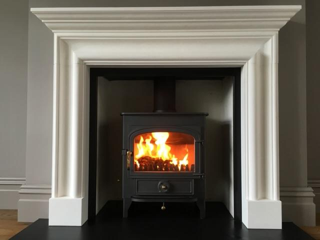 Clearview Vision 500 wood burning stove in limestone fireplace