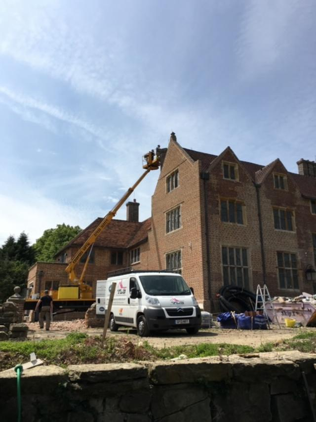 Flue liner installation using a cherry picker